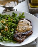 Steak with arugula stock photography