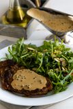Steak with arugula royalty free stock photography