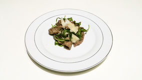 Steak with Arugula and Parmesan royalty free stock photo