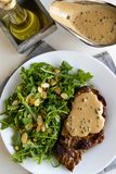 Steak with arugula. And green peppercorn sauce stock photo