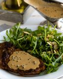 Steak with arugula stock images
