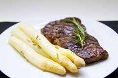 Steak and Asparagus. On a plate Royalty Free Stock Photos