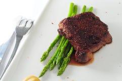Steak asparagus Stock Photography