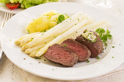 Steak with Asparagus Stock Images