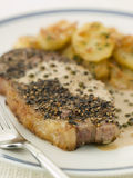 Steak au Poirve' with Saut Potatoes Royalty Free Stock Photo