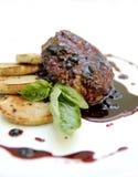 Steak auf Platte Stockbilder