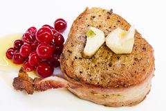 Steak  in bacon with cranberry, pepper, honey and garlic. Royalty Free Stock Image