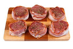 Steak with bacon and spices prepared for grilling. Stock Images