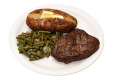 Steak, Baked Potato, and Green Beans Royalty Free Stock Photos