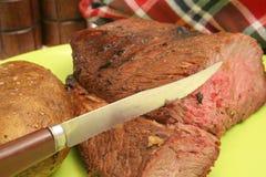 Steak baked potato & napkin Stock Photos