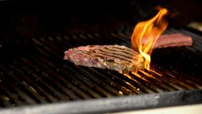 Steak on the barbecue with flames. Steak getting cooked on the barbecue with naked flames stock video footage