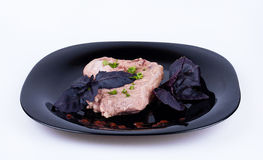 Steak with basil. On the dark plate Royalty Free Stock Photos