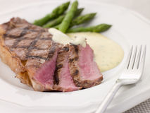 Steak Bearnaise with Asparagus Spears. On a plate with folk royalty free stock images