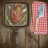 Steak beef on black square frying pan royalty free stock photography