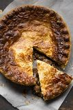 Steak beef gravy pie. On parchment paper Stock Photos
