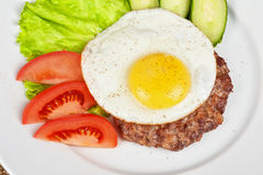 Steak beef meat with fried egg Royalty Free Stock Images