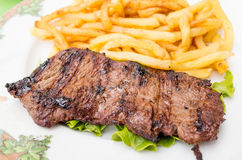 Steak beef meat with tomato and french fries Royalty Free Stock Photo