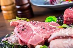 Steak.Beef steak.Meat.Portioned meat.Raw fresh meat.Sirloin steak.T-Bone steak. Flank steak. Duck breast. Vegetable decoration. Stock Photos