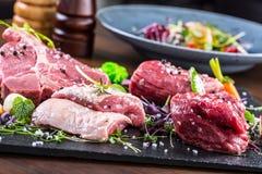 Steak.Beef steak.Meat.Portioned meat.Raw fresh meat.Sirloin steak.T-Bone steak. Flank steak. Duck breast. Vegetable decoration. Stock Photo