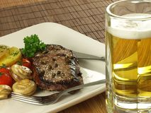 Steak with beer Stock Photo