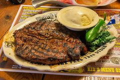 Steak at Big Texan Steak Ranch in Amarillo, TX. Amarillo, Texas, United States of America - January 1, 2017. Steak at Big Texan Steak Ranch in Amarillo, TX stock images