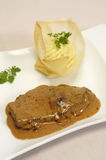 Steak with black pepper sauce Stock Images
