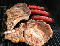 Steak and Bratwurst on a Grill Royalty Free Stock Image