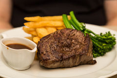 Steak with Broccoli and Fries Royalty Free Stock Photography