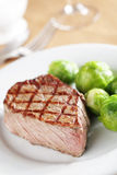 Steak with Brussels sprout Royalty Free Stock Photo