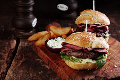 Steak Burgers on Tray with Potato and Dip Royalty Free Stock Photography