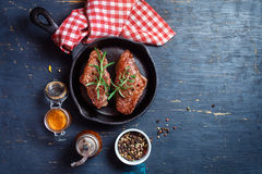 Steak on cast iron frying pan Royalty Free Stock Photos