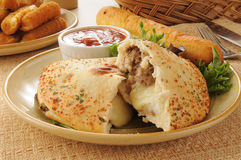 Steak and cheese calzone Royalty Free Stock Images