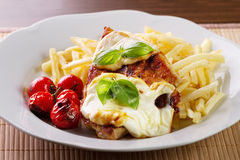 Steak. With cheese and french fries Stock Photos