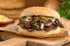 Steak and Cheese Mushroom Melt. A classic steak melt sandwich with green pepper and onions royalty free stock images