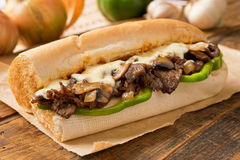 Steak and Cheese Sub. A delicious oven baked steak and cheese submarine sandwich with mushrooms, green peppers, and onion Stock Photos