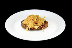 Steak and cheese. Steak with cheese on top royalty free stock photo