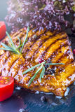 Steak chicken breast olive oil cherry tomatoes pepper and rosemary herbs. Stock Photo