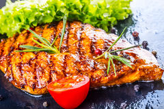 Steak chicken breast olive oil cherry tomatoes pepper and rosemary herbs. Royalty Free Stock Photography