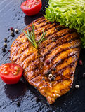 Steak chicken breast olive oil cherry tomatoes pepper and rosemary herbs. Stock Photos