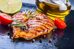 Steak chicken breast olive oil cherry tomatoes pepper and rosemary herbs. Royalty Free Stock Images