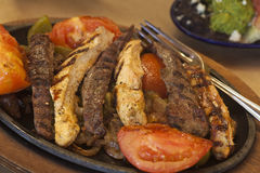 Steak and chicken fajitas with gucamole Royalty Free Stock Photo