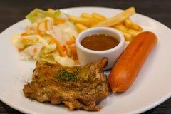 Steak chicken and hotdog with salad . Stock Photos