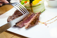 Steak and chips. Being a close-cut steak cutlery Royalty Free Stock Images