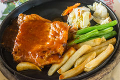 Steak and chips on black plate Royalty Free Stock Image