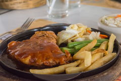 Steak and chips on black plate Royalty Free Stock Photo