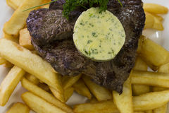 Steak and chips with garlic butter Stock Photo