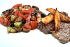 Steak chips and salad. Steak with sweet potato chips and tomato salad Stock Image