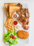 Steak combo. Witch beef chicken fish and salad in white plate stock photo