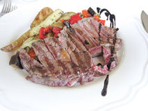 Steak cooked rare on a white plate Stock Photo