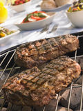 Steak Cooking On A Grill Stock Photo